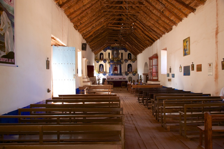 The nave of Iglesia San Pedro, with roof beams of cactus wood
