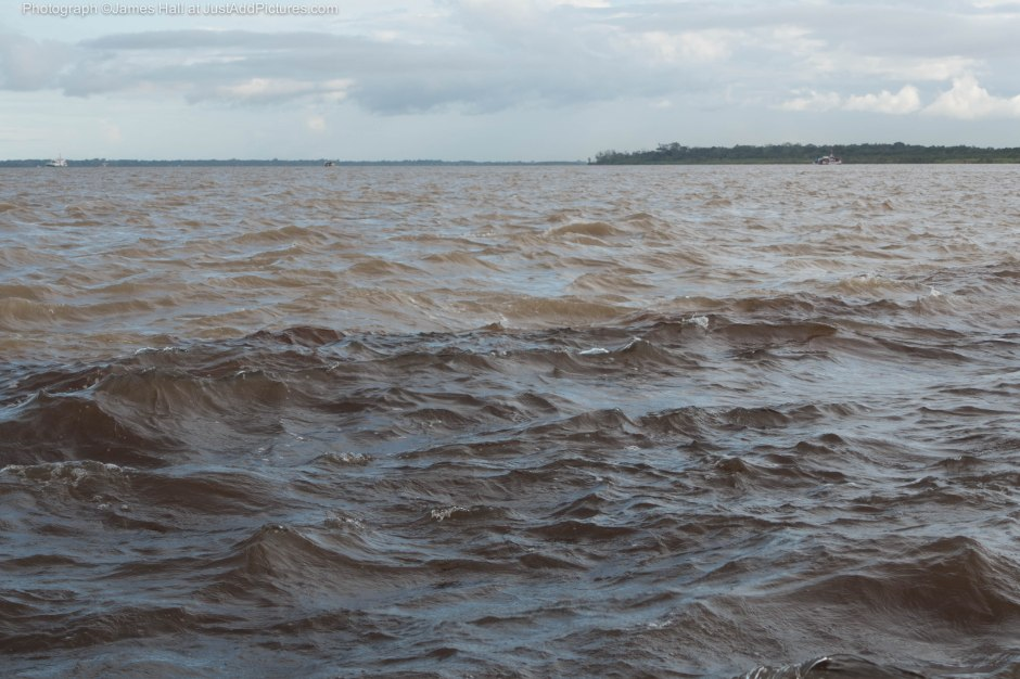 The two rivers have met, but not yet mixed. For several kilometres there remains a clearly visible distinction between water from the Rio Negro and water from the Rio Solimoes.
