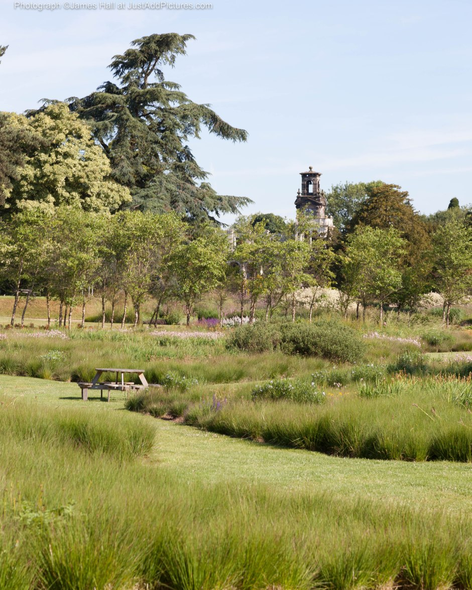 Informal gardens looking over towards the remaining wing of the original house